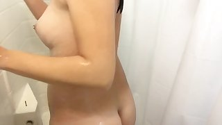 Teen masturbation with toy in shower