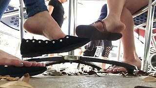 Candid Feet Dangle Under Table POV