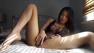 Asian Babe masturbating and riding Dildo