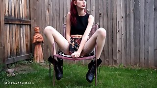 Redhead creamy upskirt masturbation in backyard wearing boots and stockings