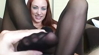 Hot footjob from young redhead, cum on stockings