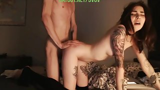 Tattooed girl, with a guy having sex in front of the camera
