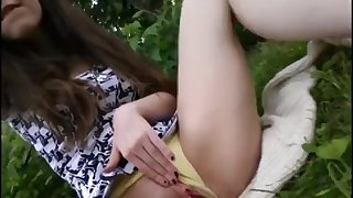 Young girl schoolgirl masturbating alone in the park