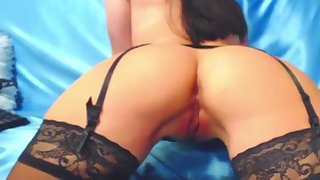 a girl in black stockings caresses herself with her fingers