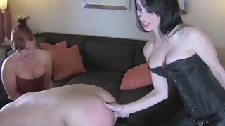 three young sexy girls abuse a guy in the ass with a strapon