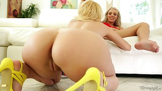 Blonde lesbians licking on the sofa